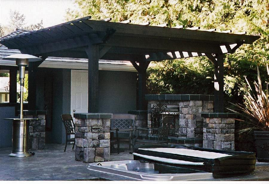 outdoor covered seating area with fireplace