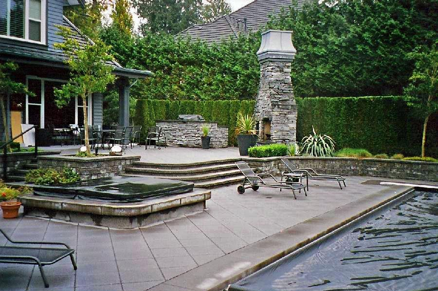 view of a backyard with covered spa and sunloungers