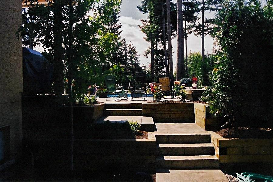 view of stairs in a backyard with sunshine