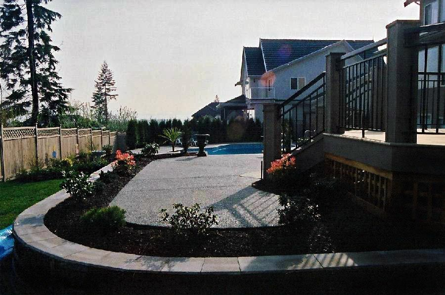 view of a backyard with a deck and spa