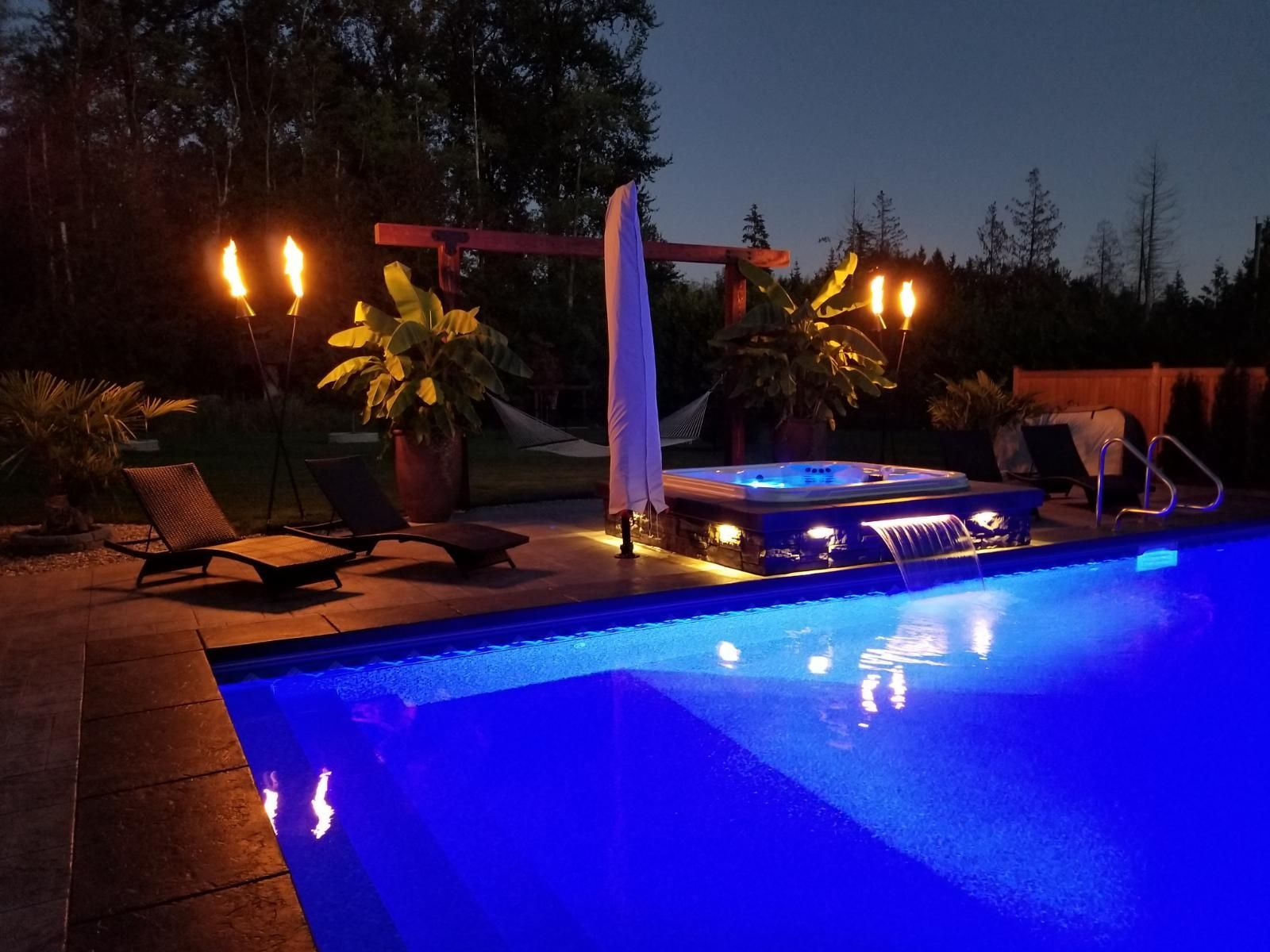 pool with lights and spa